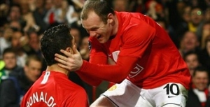 Rooney gives some lovin' to Ronaldo